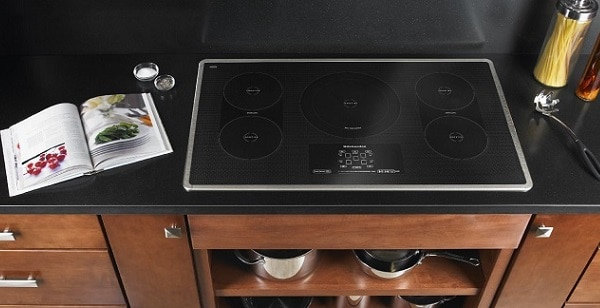 whirlpool cooktop turns on by itself